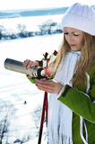 A beautiful girl drinking at ski resort Royalty Free Stock Photo
