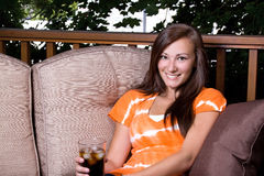 Beautiful Girl Drinking Soda in the Patio Royalty Free Stock Photos