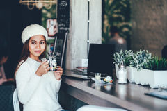 Beautiful girl drinking tea in a cafe. Beautiful girl in white long sleeve drinking tea in a cafe Stock Images