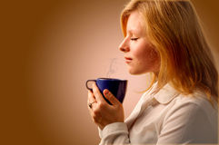 Beautiful Girl Drinking Tea or Coffee. Stock Photos