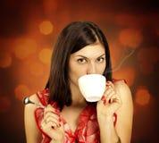 Beautiful Girl Drinking Tea or Coffee in Cafe. Stock Photography