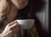 Beautiful Girl Drinking Tea or Coffee in Cafe Stock Photos