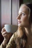 Beautiful Girl Drinking Tea or Coffee in Cafe Stock Photo