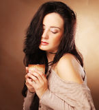 Beautiful girl drinking tea or coffee. Royalty Free Stock Photography