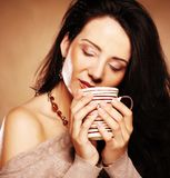 Beautiful girl drinking tea or coffee. Royalty Free Stock Photo