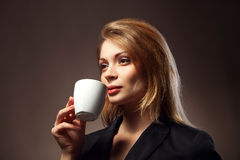 Beautiful Girl Drinking Tea or Coffee stock photo