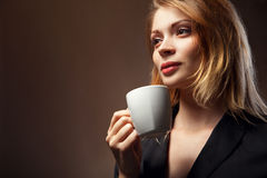 Beautiful Girl Drinking Tea or Coffee Royalty Free Stock Photography
