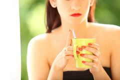 Beautiful Girl Drinking Tea or Coffee Indoor. Green Blurred Background Stock Photos