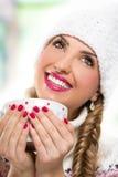 Beautiful girl drinking tea Stock Images