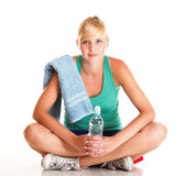 Beautiful girl drinking water blue bottle isolated Royalty Free Stock Image