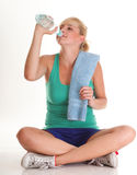 Beautiful girl drinking water blue bottle isolated Stock Photo