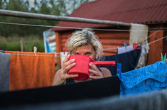 Beautiful Girl is drinking water from the bucket in the village Stock Image