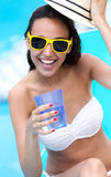 Beautiful girl drinking water at the swimming pool. Stock Photo