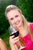 Beautiful girl drinking wine Stock Photo