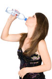 Beautiful  girl drinks Stock Photography