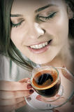 Beautiful girl drinks coffee Royalty Free Stock Photography