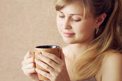Beautiful girl drinks a drink from a cup Stock Photo
