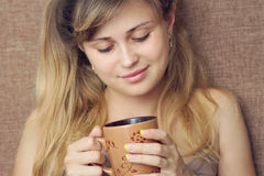 Beautiful girl drinks   Royalty Free Stock Photo