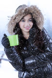 Beautiful girl drinks hot tea Royalty Free Stock Photography