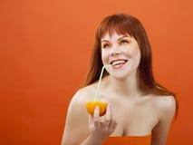 Beautiful girl drinks juice Stock Image