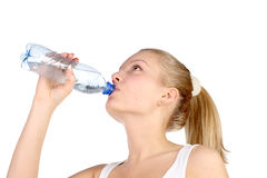 Beautiful girl drinks mineral water Stock Photo