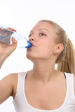 Beautiful girl drinks mineral water Royalty Free Stock Image