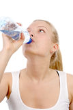 Beautiful girl drinks mineral water Royalty Free Stock Images