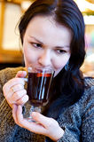 Beautiful girl drinks mulled wine Royalty Free Stock Photography