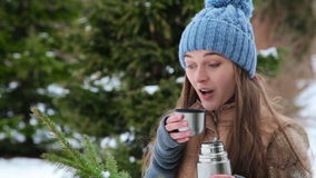 Beautiful girl drinks tea from a thermos stock footage