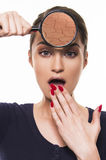 Beautiful girl with dry and damaged face skin concept with magnifier Stock Photography