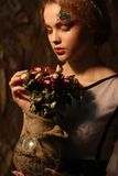 Beautiful girl with dry roses Stock Image