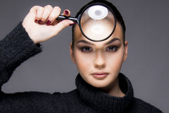 Beautiful girl with dry skin problem close up concept. Beautiful girl holding magnifier close up concept with skin problem dry skin stock images