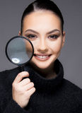 Beautiful girl with dry skin problem close up concept. Beautiful young girl holding magnifier close up her dry skin face beauty concept royalty free stock photo