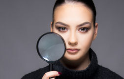 Beautiful girl with dry skin problem close up concept. Beautiful young girl holding magnifier close up her dry skin face beauty concept royalty free stock photos