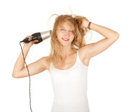 Beautiful girl drying her hair by dryer, Royalty Free Stock Images