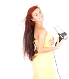Beautiful girl drying her hair by dryer Stock Image