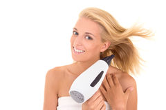 Beautiful girl drying her hair with hairdryer Royalty Free Stock Images