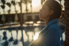 Girl drying with towel by the pool Royalty Free Stock Photos