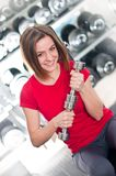 Beautiful girl with dumbbells Royalty Free Stock Images