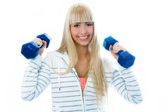 Beautiful girl with dumbbells Stock Photo