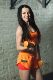 Beautiful girl with dumbbells. With a smile on her face while training in the gym Royalty Free Stock Photos