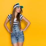 Beautiful Girl In Dungarees And Plastic Sun Visor Royalty Free Stock Image
