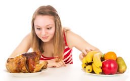 Beautiful girl eagerly looking for fried chicken Royalty Free Stock Photo