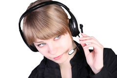 The  beautiful girl in ear-phones Stock Image