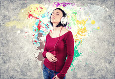 Girl with earphones Stock Image