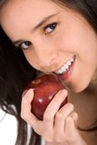 Beautiful girl eating an apple Royalty Free Stock Images