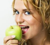 Beautiful girl eating apple. royalty free stock photo