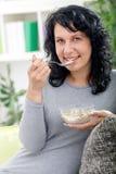 Beautiful girl eating cereal Stock Photos