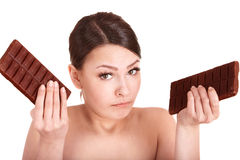Beautiful girl eating chocolate bar. Stock Image