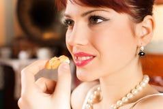 Beautiful girl eating Stock Image